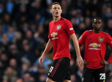 Nemanja Matic walks off the pitch after his sending off.