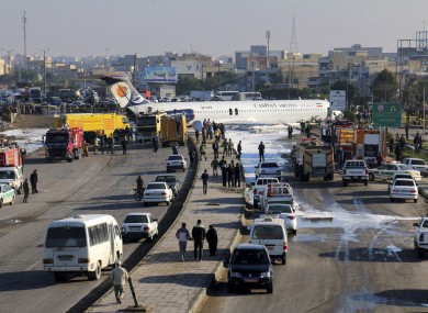 A passenger plane sits on a road outside Mahshahr airport in Iran