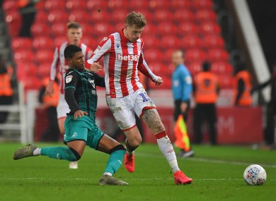 Stoke City's James McClean is tackled by Rhian Brewster of Swansea.