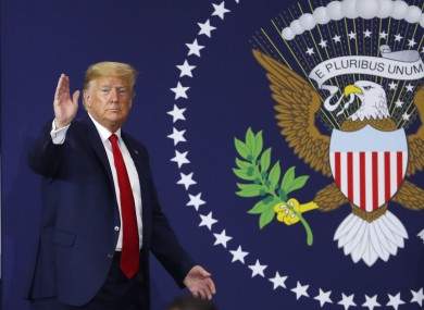 President Donald Trump waves after speaking about the USMCA trade deal at a Dana plant in Warren, Michigan.