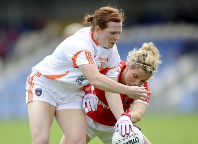 Caoimhe Morgan in action against former Cork star Valerie Mulcahy.