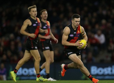 Conor McKenna in action for Essendon in the AFL last summer.