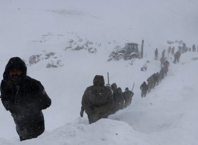 A huge team of rescue workers had been sent to find people missing in an earlier avalanche.