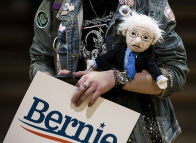 A Sanders supporter holds a 'Bernie Doll' at a rally in Virginia.