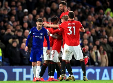 Manchester United players celebrate after team mate Anthony Martial (second left) scores.