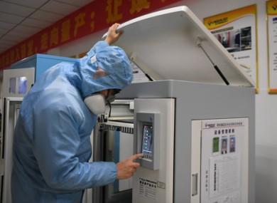 A worker uses a 3D printer to make goggles in China.