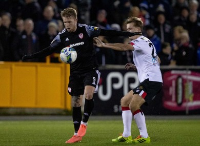 Dundalk's Daniel Cleary with Tim Nilsen of Derry City.