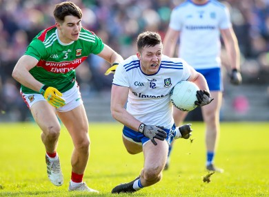 Dessie Ward goes to ground with Mayo's Oisin Mullin in close attention.