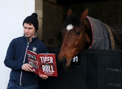 Leon Carroll of The Racing Post with two time Grand National winner Tiger Roll during the stable visit to Gordon Elliott's yard at Cullentra House, Co. Meath.
