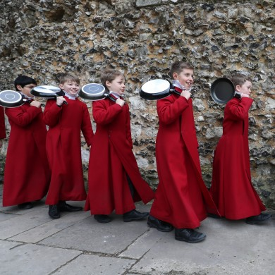 Choristers from Winchester Cathedral walk to the race start ahead of the Shrove Tuesday pancake race