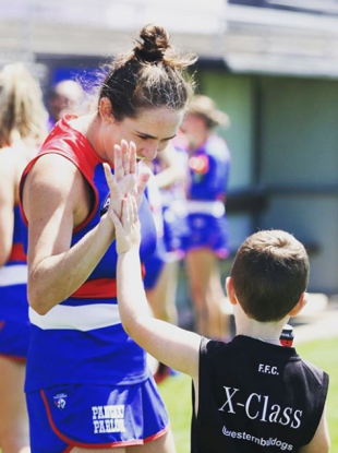 Katy Herron with her son, Joshua, at training with the Western Bulldogs.