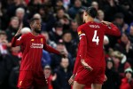 Liverpool's Georginio Wijnaldum (left) celebrates scoring.