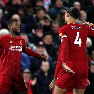 Liverpool's Georginio Wijnaldum (left) celebrates scoring.