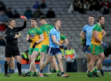 Referee Maurice Deegan shows red cards to John Small and Michael Murphy.