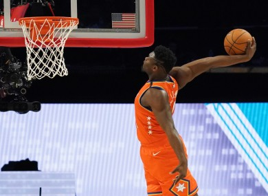 Zion Williamson getting a basket in the  NBA Rising Stars basketball game.