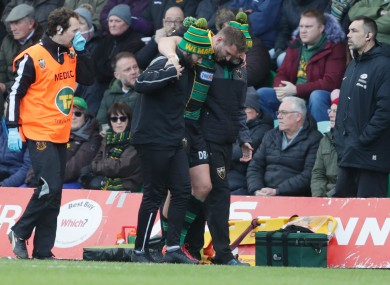 Dan Biggar is helped off the pitch.