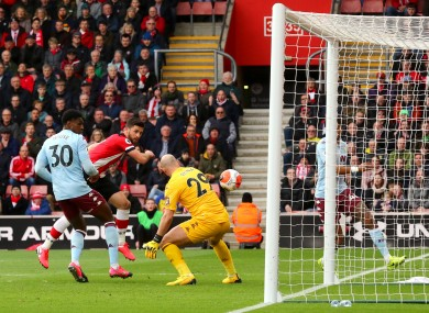 Southampton's Shane Long (second left) scores his side's first goal of the game.