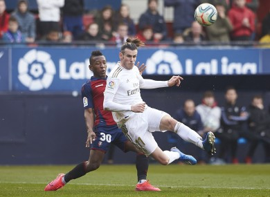 Gareth Bale is challenged by Pervis Estupinan of Osasuna.