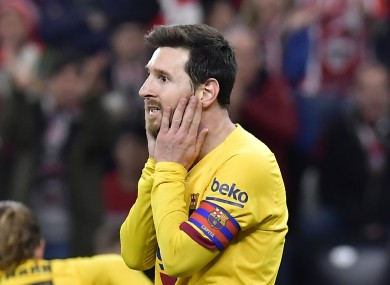 Lionel Messi reacts to a missed chance.