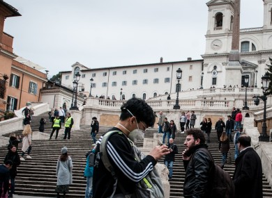 Tourists wearing masks in the streets of Rome.