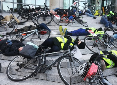 Cyclists lie down on the steps of Dublin City Council in a protest after Neeraj Jain was killed cycling to work last November.