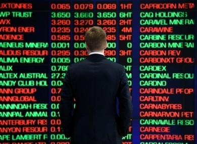 A man is seen looking at the digital market boards at the Australian Stock Exchange.