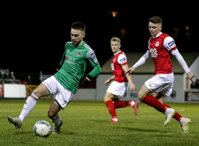 Cork City's Dylan McGlade is tracked by Dean Clarke of St Pat's.