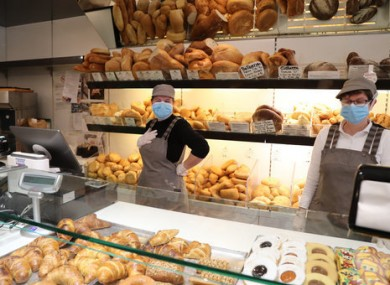 Bakers in Italy wear masks at work.