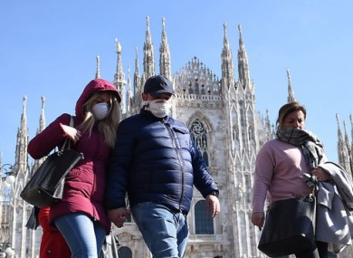 People wear masks in Milan, one of the areas placed in isolation.