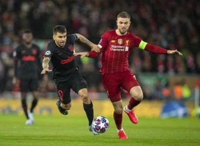 Liverpool captain Jordan Henderson and Atletico Madrid's Angel Correa.