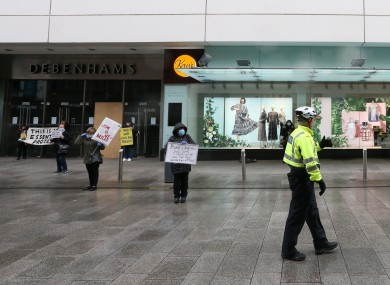 Pictured are Gardai on the scene as workers protest outside the Henry Street branch of Debenhams yesterday.