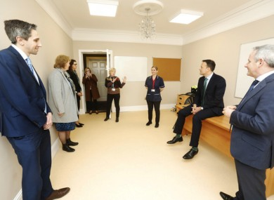 Taoiseach Leo Varadkar, Minister for Health Simon Harris and Paul Reid CEO of the HSE in one of the clinic rooms in the Citywest Hotel today.