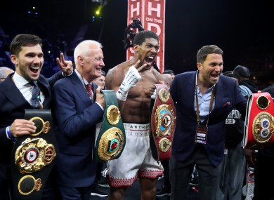 Barry Hearn (second left) alongside Anthony Joshua (centre) and Eddie Hearn (right).