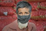 A labour-worker wearing a mask in the streets of Sylhet, Bangladesh.