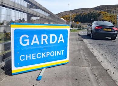 Gardai mount coronavirus checkpoints on the border with Northern Ireland at Carrickarnon, Co Louth