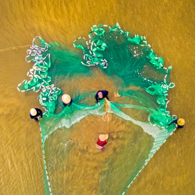 Aerial view of fishermen in the estuary in Quang Ngai Province, Vietnam.