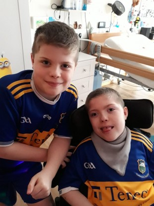 Liam (r) pictured with his twin brother Sean (l).