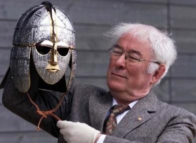 Seamus Heaney holding a replica saxon helmet in 2002.