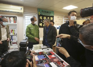 Lam Wing-kee (center right) and staff at the Causeway Bay Book shop is congratulated by Taiwan's Legislative Yuan Speaker Yu Shyi-kun (center left).