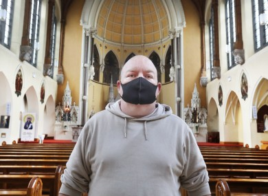 Jason Berry from Nutgrove wearing a face mask in the Capuchin Friary on Church Street in Dublin in April.