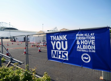 A 'Thank You NHS' banner from Brighton & Hove Albion Football Club is displayed near the entrance of the drive-in coronavirus testing centre at the Amex Stadium.