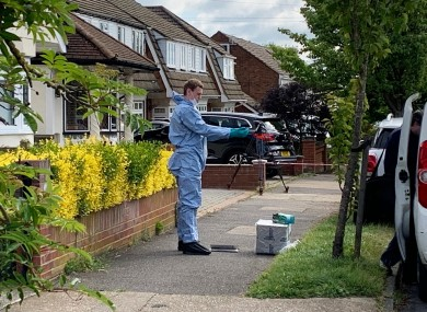 A police forensic officer at the scene in Kerry Drive, Upminster, East London