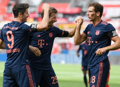 Lewandowski (left) celebrates with Thomas Muller and Leon Goretzka (right.)