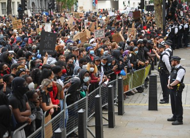 Protesters face police at the entrance to Downing Street in London during a Black Lives Matter protest rally.