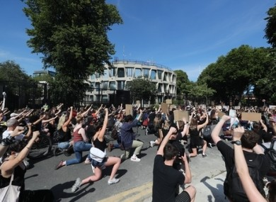 People at a Black Lives Matter protest rally outside the US Embassy in Dublin on Monday.
