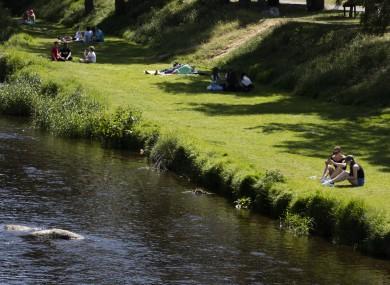 People enjoying the sun yesterday along the River Liffey in Newbridge, Co Kildare