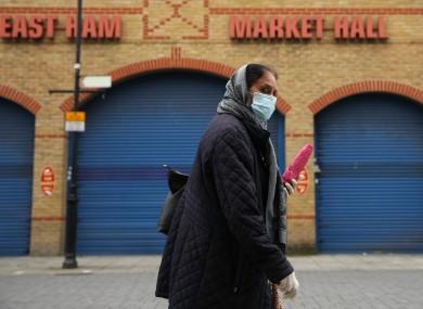 A woman wearing a mask in London.