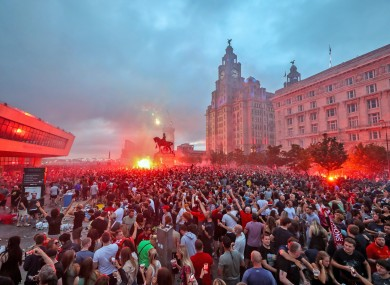 Violent scenes have been captured in a clash between police and football fans in Liverpool.