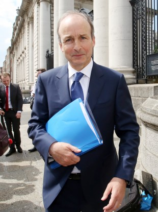 Fianna Fáil leader Micheál Martin leaving Government Buildings on 15 June after government formation talks.