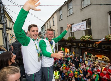Olympic medallists Paul and Gary O'Donovan parade through Skibbereen on an open top bus.